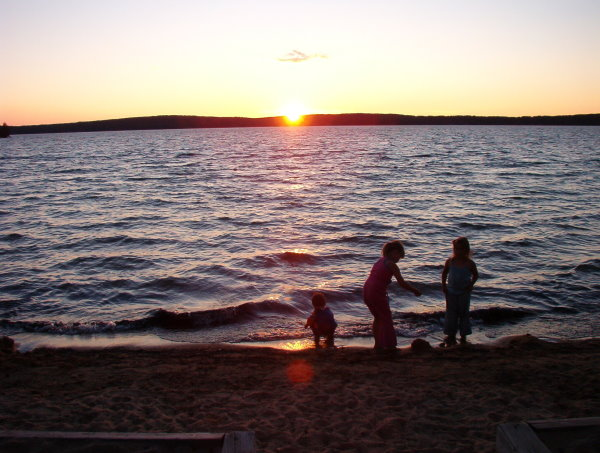 Blue Lake Provincial Park North Western Ontario.  Nice sunsets but crowded campground.  The beach is long from end to end but very small from the a wall to the water. Picture is my kids on the beach there in 2005.