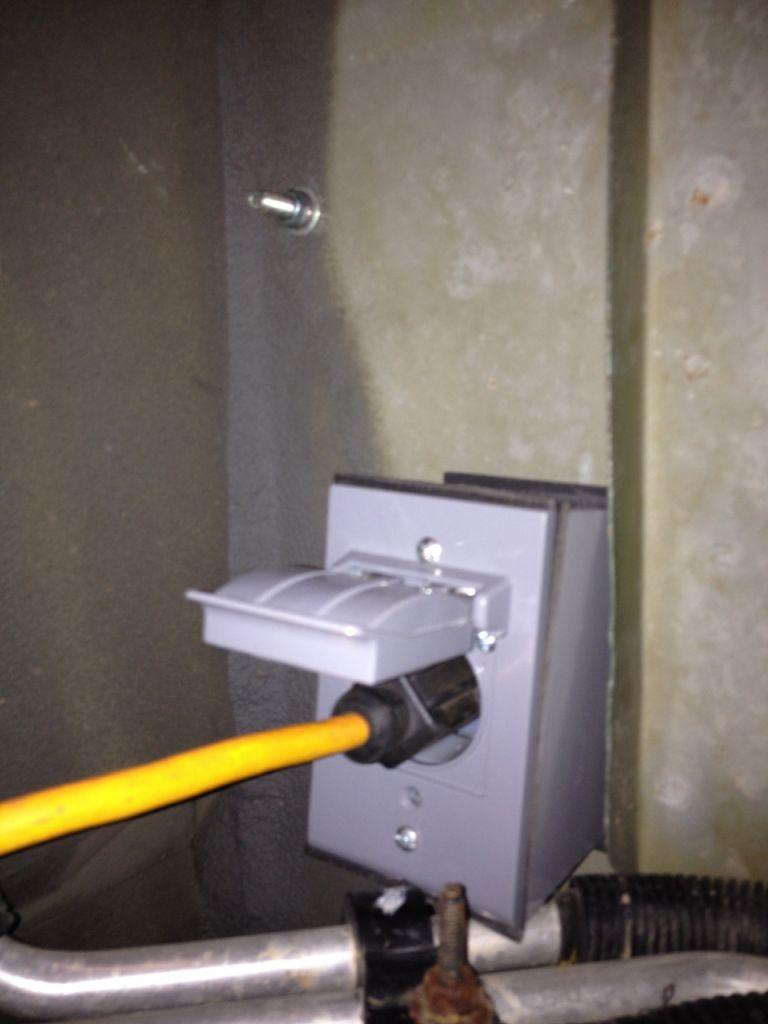 shore power plug on the underside exterior.