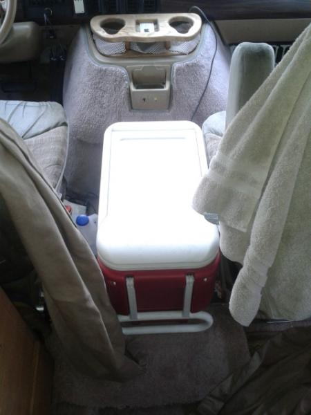 We use ice chest between front seat for bread n chips,potatos etc...If fridge ever poops out we can use ice n move stuff from fridge to chest n vice a versa.