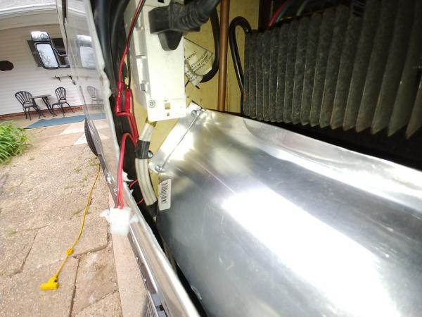 Sheetmetal baffle forced all air drawn out of the space to pass through the fins. Without a baffle the hot air can just recirculate and exhaust fans alone would not force air through the fins.
