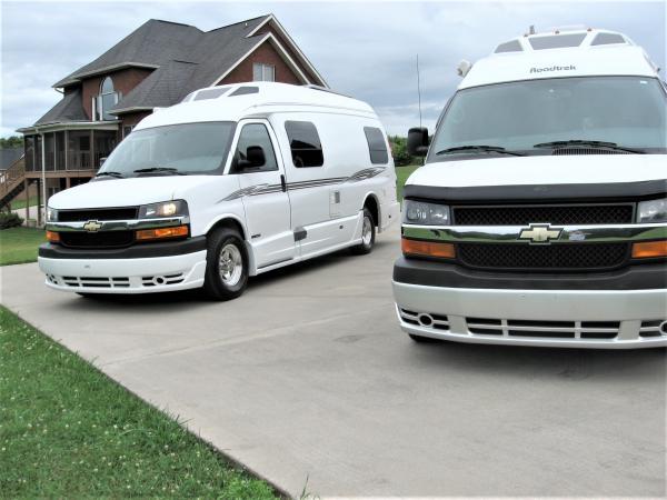 2007 Roadtrek 210 Versatile on right and 2016 Roadtrek 210 Popular on left.