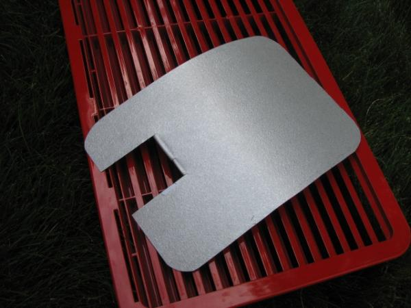 Flame for refrigerator is in trailing edge of compartment and gets blown out while traveling. I made a baffle out of a piece of step flashing. Cut from 8x12 to 8x10, rounded corners and slotted for tubing.