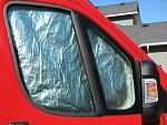Here is the passenger side window covering in place. The driver's and windshield shades are the same. I'm happy with the two side ones, but the...
