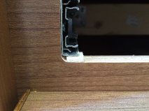 Wooden shim to support drawer glide. Latch on drawer now stays in contact with catch when drawer is filled with heavy stuff.