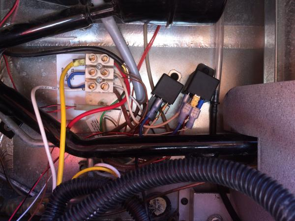 This is the back of the fridge where I wired another relay to make 12v running of the fridge conditional on the engine running. Turn the engine off and the fridge turns off, too.
