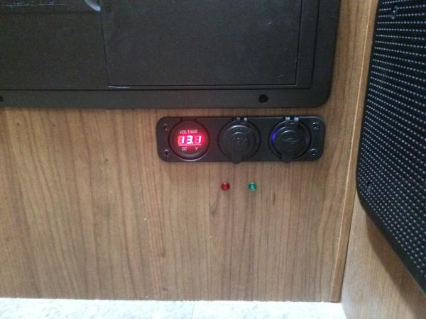 I've got the fridge wired in such a way that if the van engine is off, the fridge won't get 12v power to the heater bulb. In that case, the red LED will light alerting me that I need to switch it over to propane or 120v or just ignore it. The green LED lights when the fridge is on 12v.