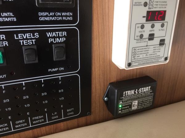 Trik-L-Start moved inside under Trimetric RV2030 battery Monitor