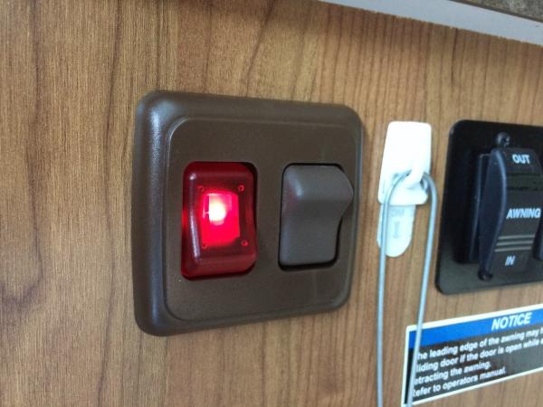 Lighted porch light switch
