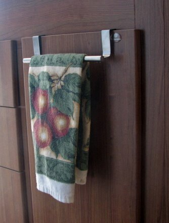 Kitchen Cabinet Towel Bar. This one just hangs over the door. It has rubber pads where it touches wood. Got it at Camping World. It is identical to the bar in the bathroom, except for how it attaches.