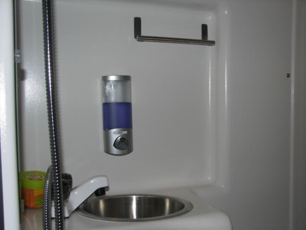 Soap Dispenser and Towel Bar. Dispenser is from HomeDepot. Towel Bar is from Amazon. Both are attached with tape.