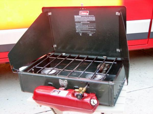 Coleman 2 burner gas stove circa 1987. Nothing says camping quite like burning all your arm hairs off every time you light the stove.