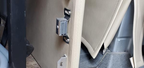 """Added a magnetic clasp on the right side to hold the """"door"""" shut.  Although the lever used to raise and lower the sofa bed kinda does the same thing."""