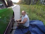 """Changing the tire at the side of the Interstate in Vermont, after waiting two hours.  AAA contractors refused to come - """"too dangerous.""""  Tire """"blew..."""