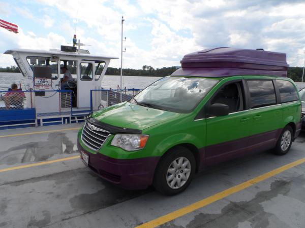 """Waiting for the Ticonderoga Ferry linking NY and Vermont.  The color scheme makes for an instant conversation starter...and ,no, we are not going to repaint the vehicle.  I do need to buff out the oxidized fiberglass """"Penthouse""""."""