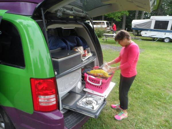 The kitchen is under the open tailgate, which provides some protection from rain.  It has one built-in butane burner, with another that can be used anywhere. The Isotherm refrigerator works well, until the temp rises much above 80 degs.  The we added gallon bags of ice to help keep things cool.  There is also a sink, which we have not used.