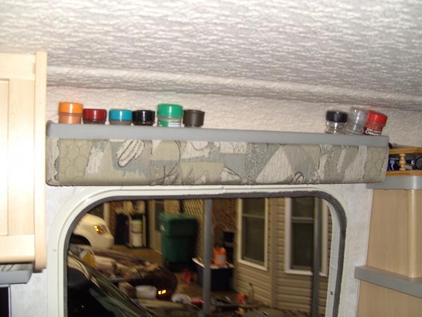 Upside down Shade over Door for spice rack.