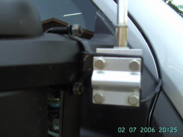 CB Antenna with Muffler Clamp used because of odd mirror arm.