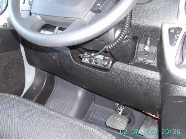 """CB Placement under steering wheel area.  I had to drill out a 1"""" hole for the CB to fit the wires thru."""