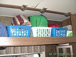Storage Baskets used to keep objects organized in overhead storage bins.