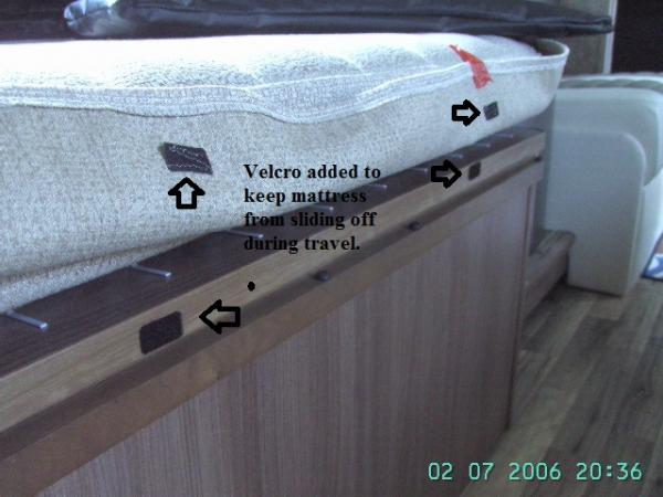 Velcro on Mattress to keep it from falling off into the floor when traveling down the road.  The bouncing down the road moves the mattress that sets on top of the plastic box springs.